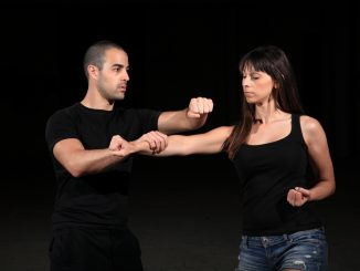 instructor teaching self defense
